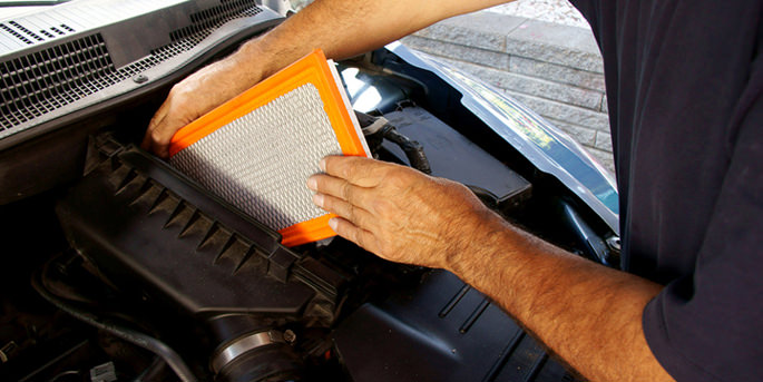 Man replacing car air filter